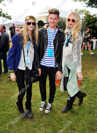 Poppy Delevigne, Henry Holland, Chloe Develigne poses in the Barclaycard Unwind Lounge, at the Barclaycard Wireless Festival 2012 on in London