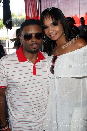 Carl Payne and Beth Payne pose at Bikini Swim Club Gloria Govan Edition at the Custom Hotel, in Los Angeles