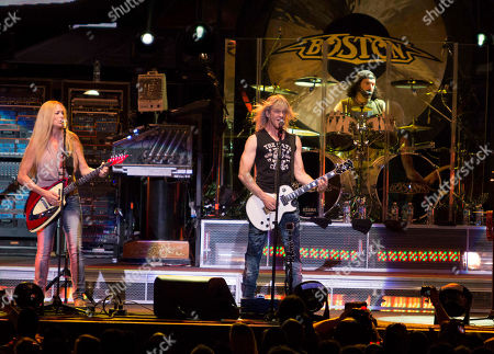 Stock Image of Tom Scholz, Gary Pihl, Curly Smith, Kimberley Dahme, Jeff Neal, Tommy DeCarlo, David Victor and Tracy Ferrie with Boston performing as part of the Heaven On Earth Tour at Verizon Wireless Amphitheater at Encore Park, in Atlanta