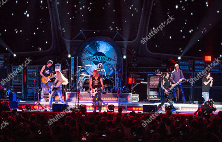 Stock Photo of Tom Scholz, Gary Pihl, Curly Smith, Kimberley Dahme, Jeff Neal, Tommy DeCarlo, David Victor and Tracy Ferrie with Boston performing as part of the Heaven On Earth Tour at Verizon Wireless Amphitheater at Encore Park, in Atlanta
