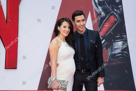 Lindsey Cole and Russell Kane pose for photographers upon arrival at the premiere of the film Ant Man in London