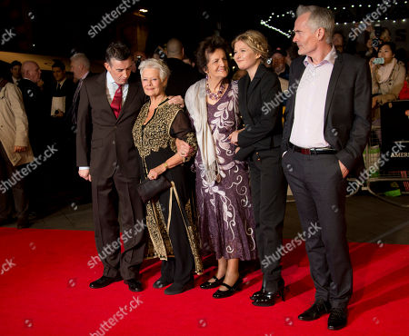 British actors Steve Coogan, left to right, and Dame Judi Dench, arrive with Philomena Lee, centre, the character she portrays in the film, Sophie Kennedy Clark and Martin Sixsmith, right, on the red carpet for the screening of Philomena, as part of the 57th BFI London Film Festival, at a central London cinema