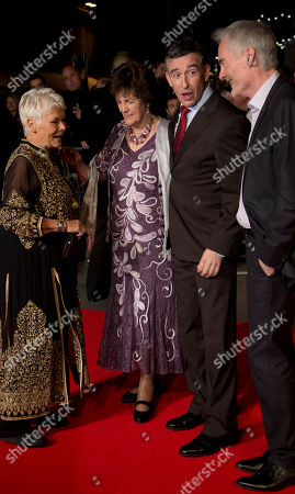 British actress Dame Judi Dench, left, arrives with Philomena Lee, centre, the character she portrays in the film, stand with British actor Steve Coogan, centre right, and the man he portrays in the film, Martin Sixsmith, right, on the red carpet for the screening of Philomena, as part of the 57th BFI London Film Festival, at a central London cinema