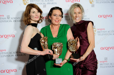 Jodie Whittaker, Olivia Colman and Simone McAullay pose for photographers in the winners room at the British Academy Television Awards at a central London venue