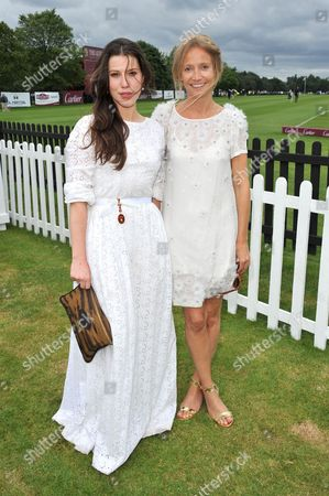 Lily Lewis and Martha Ward attend the Cartier Queen's Cup polo final at Guards Polo Club in Windsor Great Park, on . This year's cup final marks Cartier's 30th year of polo sponsorship
