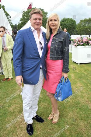Rod Barker, left and Tania Bryer attend the Cartier Queen's Cup polo final at Guards Polo Club in Windsor Great Park, on . This year's cup final marks Cartier's 30th year of polo sponsorship