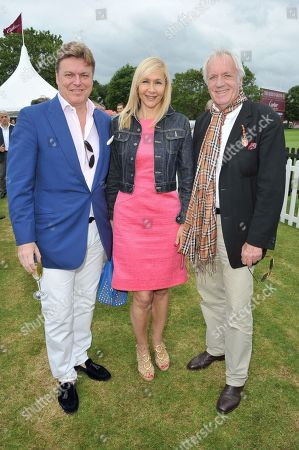 From left, Rod Barker, Tania Bryer and John Rendell attend the Cartier Queen's Cup polo final at Guards Polo Club in Windsor Great Park, on . This year's cup final marks Cartier's 30th year of polo sponsorship