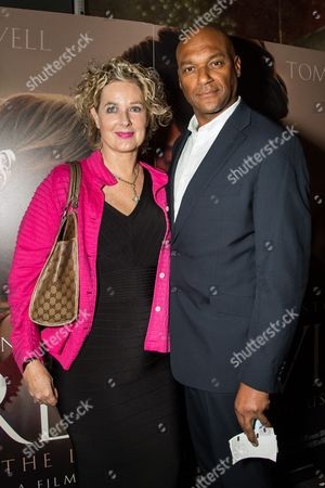 Colin Salmon and Fiona Hawthorne pose for photographers upon arrival at the premiere of the film 'Dare to Be Wild', in London