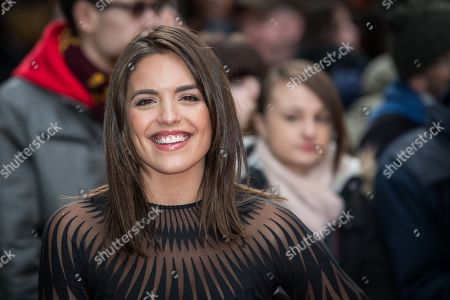 Olympia Valance poses for photographers upon arrival at the Empire Film Awards in London