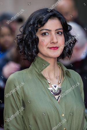 Rakhee Thakrar poses for photographers upon arrival at the Empire Film Awards in London