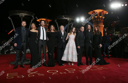 Actors Joel Edgerton, Golshifteh Farahani, Andrew Tarbet, Giannina Facio, director Ridley Scott and actors Maria Valverde, Sir Ben Kingsley, Christian Bale and Sibi Blazic pose for photographers upon arrival at the World premiere of the film Exodus: Gods And Kings in London