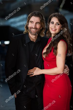 Actor Sharlto Copley and model Tanit Phoenix pose for photographers upon arrival at the premiere of the film 'Free Fire', in London