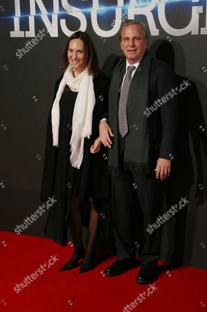 Producers Douglas Wick and Lucy Fisher pose for photographers upon arrival at a central London cinema for the World Premiere of Insurgent, . The film is part of the Divergent series and set in the dystopian ruins of a futuristic Chicago