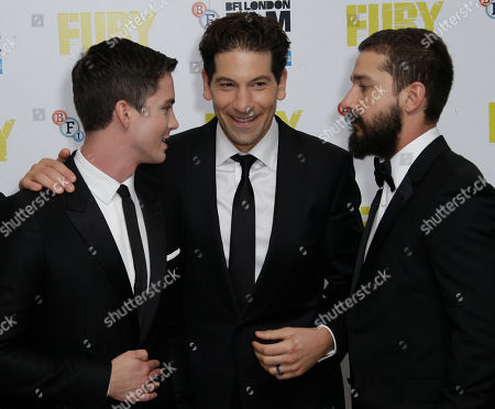 Actors, from left, Logan Lerman, Jon Bernthal and Shia LeBeouf pose for photographers at the premiere for the film Fury, which closes the BFI London Film Festival, at the Odeon cinema in central London