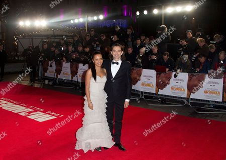 Director Justin Chadwick and wife Michelle arrive for the UK Premiere of the Long Walk to Freedom, a film based on the South African President Nelson Mandela's autobiography of the same name, to the Odeon cinema in Leicester Square, central London