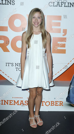 Lily Laight poses for photographers upon arrival at at the Odeon West End in London, for the premiere of the film Love, Rosie