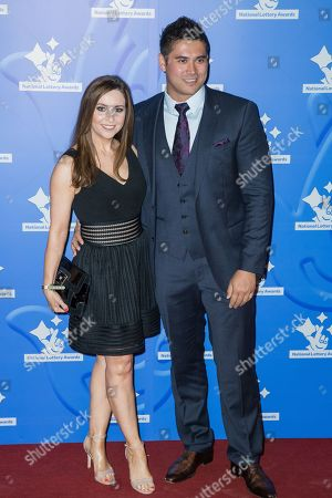 Stock Image of Ellie Crisell and Rav Wilding pose for photographers upon arrival at the National Lottery Stars 2015 event in London