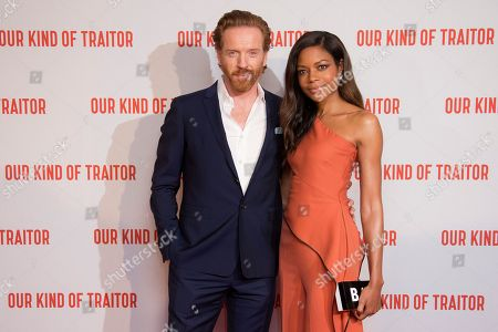 Actors Damian Lewis and Naomie Harris pose for photographers upon arrival at the UK Gala Premiere of Our Kind Of Traitor, at a central London hotel