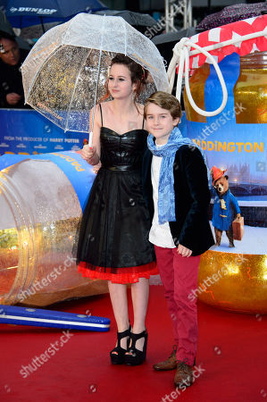 Madeleine Harris and Samuel Joslin pose for photographers upon arrival at the world premiere of the film Paddington in London