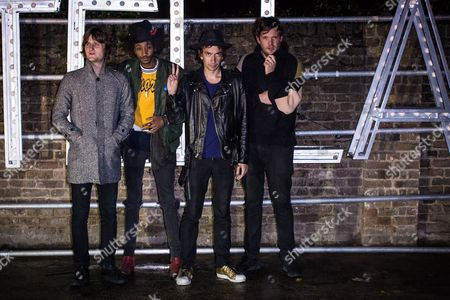 Jeff Wootton, third right, poses for photographers upon arrival at the Stella McCartney collection presentation, in London
