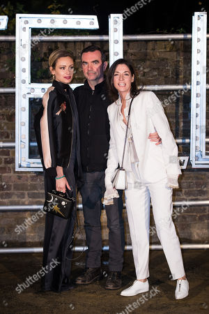 Camilla Al-Fayed, Simon Aboud and Mary McCartney pose for photographers upon arrival at the Stella McCartney collection presentation, in London