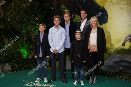 Crown Princess of Greece Marie-Chantal of Greece, right, and her family, pose for photographers upon arrival at the European premiere of the film 'The Jungle Book' in London