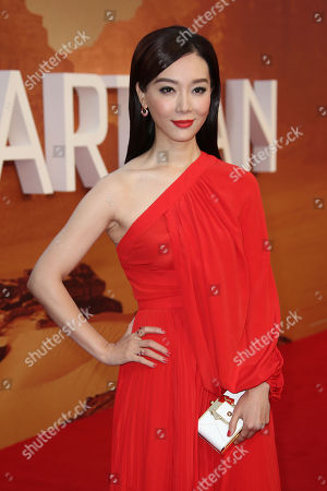 Chen Shu poses for photographs as she arrives on the red carpet for the European Premiere of, The Martian at a central London cinema