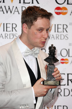 British actor Stephen Ashfield holds the award for Best Supporting Role in a Musical award for The Book of Mormon poses for photographers backstage during the Olivier Awards at the Royal Opera House in central London, . Named after the British actor Laurence Olivier, the awards are given for West End shows and other productions staged in London