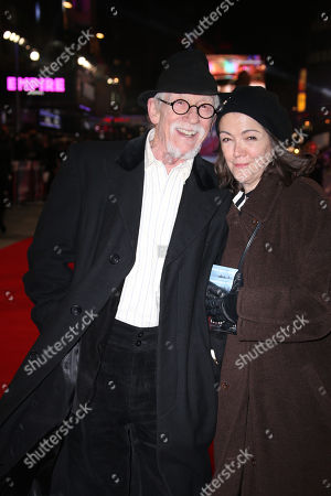 Actor John Hurt, left, and Anwen Rees-Myers pose for photographers upon arrival at the premiere of the film 'The Revenant' in London