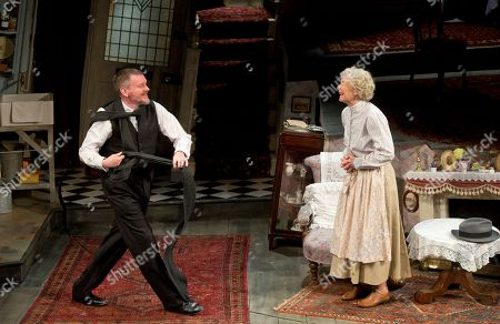Actors John Gordon Sinclair, who plays Professor Marcus, and Angela Thorne, who plays Mrs Wilberforce, perform a scene from the play, The Ladykillers, during a photo call at the Vaudeville theatre in central London