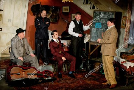 Actors, from left to right, Chris McCalphy, who plays One Round, Con O'Neill, who plays Louis, Ralf Little, who plays Harry, John Gordon Sinclair, who plays Professor Marcus and Simon Day who plays Major Courtney, perform a scene from the play, The Ladykillers, during a photo call at the Vaudeville theatre in central London
