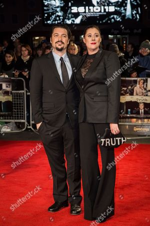 """Screenwriter James Vanderbilt poses with partner Amber Freeman upon arrival at the premiere of the film """"Truth"""", as part of the London film festival in London"""