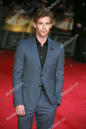 Actor Luke Treadway poses for photographers upon arrival at the premiere of the film Unbroken in London
