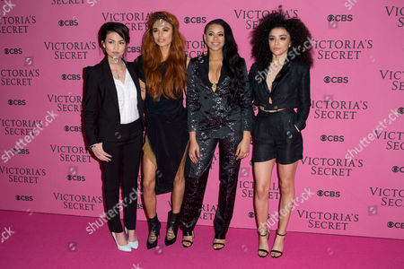 Asami Zdrenka, Jessica Kate Plummer, Amira McCarthy and Shereen Cutkelvin of Neon Jungle pose for photographers upon arrival at the Victoria's Secret fashion show in London