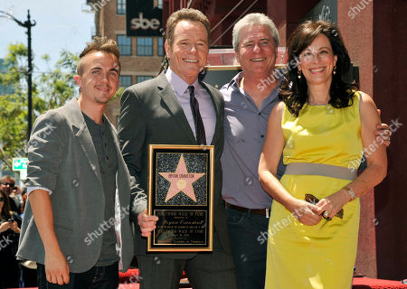 """Actor Bryan Cranston, second from left, a cast member in the television series """"Malcolm in the MIddle,"""" poses with fellow cast members Frankie Muniz, left, and Jane Kaczmarek, far right, and the show's creator Linwood Boomer after Cranston received a star on the Hollywood Walk of Fame on in Los Angeles"""