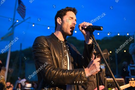 Stock Photo of Ryan Merchant of Capital Cities performs at The Surf Lodge, in Montauk