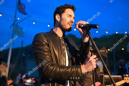 Stock Image of Ryan Merchant of Capital Cities performs at The Surf Lodge, in Montauk