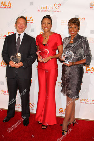 From left Jeremy Zimmer, CEO and co-founder of UTA, Robin Roberts and Sally-Ann Roberts pose with their awards at the CoachArt Gala of Champions in Beverly Hills, Calif. on