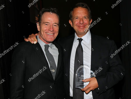 From left, Bryan Cranston and CEO and co-founder of UTA Jeremy Zimmer attend the CoachArt Gala of Champions in Beverly Hills, Calif. on