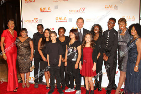 Stock Image of Robin Roberts, left, Chandra Wilson, second from left, CEO and co-founder of UTA Jeremy Zimmer, center, Sally-Ann Roberts, second from right, executive director of CoachArt Thyonne Gordon, Ph.D., right, and the musical group Electric Jammers arrive at the CoachArt Gala of Champions in Beverly Hills, Calif. on
