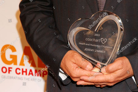 """Jeremy Zimmer, CEO and co-founder of UTA, poses with the """"Champion of Heart and Humanity"""" award at the CoachArt Gala of Champions in Beverly Hills, Calif. on"""