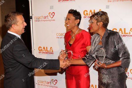 From left Jeremy Zimmer, CEO and co-founder of UTA, Robin Roberts and Sally-Ann Roberts arrive at the CoachArt Gala of Champions in Beverly Hills, Calif. on
