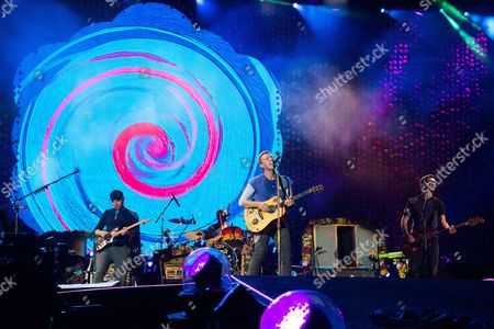 Jonny Buckland, left, Chris Martin and Guy Berryman from the band Coldplay performs at MetLife Stadium, in East Rutherford, New Jersey
