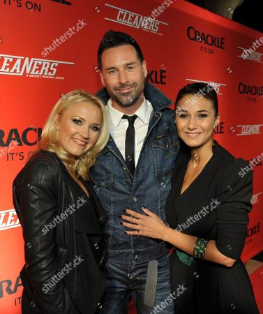 """From left, Emily Osment, writer/director Paul Leyden and Emmanuelle Chriqui attend the screening of """"Cleaners"""" at Sony Pictures Studio's Cary Grant Theater, in Culver City, Calif"""
