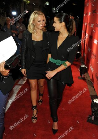 """Emily Osment, left, and Emmanuelle Chriqui attend the screening of """"Cleaners"""" at Sony Pictures Studio's Cary Grant Theater, in Culver City, Calif"""