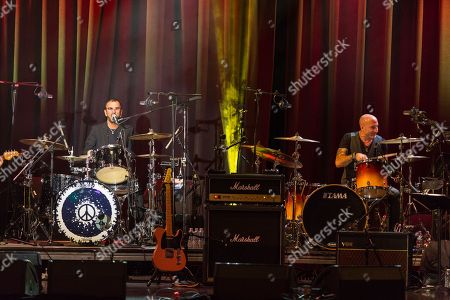"""Ringo Starr (L) and Kenny Aronoff on stage during the David Lynch Foundation Honors Ringo Star """"A Lifetime of Peace & Love"""" event held at the El Rey Theatre on in Los Angeles"""