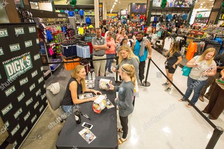 American professional beach volleyball player, three-time Olympic gold medalist, and a one-time Olympic bronze medalist Kerri Walsh Jennings meets with fans and signs autographs during a recent store appearance at the new DICK's Sporting Goods Grand Opening Celebration, in Katy, Texas