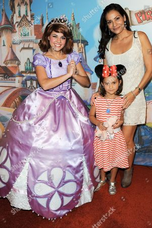 Constance Marie, far right, and daughter Luna Marie, Katich, center, pose with Disney Princess model at the Disney Junior Live On Tour Pirate & Princess Adventure at the Dolby Theatre on in Los Angeles