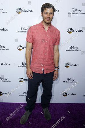 Zach Gilford arrives at the at Disney Media Distribution International Upfronts at The Walt Disney Studios Lot, in Burbank, Calif