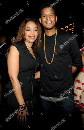 Stock Image of ESSENCE Multicultural Marketing Mgr. Shawn Thompson, left, and Roble Ali attend the 5th Annual ESSENCE Black Women in Music reception, on at 1 OAK in Los Angeles, Calif
